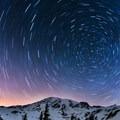 Headlamps illuminate multiple routes on Mount Rainier (14,411 ft).- The Pacific Northwest