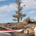 A kayaker at camp on Blind Island.- Kayaking in the San Juan Islands