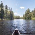 Paddling up a narrow river.- Three Adirondack Paddling Adventures for your Bucket List