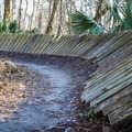 A plank berm is one of many obstacles and improvements made to the Bonnet Carre Spillway Trail.- Incredible Louisiana Hiking + Biking Trails For Your Bucket List