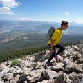 A hiker ascends a boulder field on the northeastern slope of Buffalo Mountain. - Dillon Reservoir's Best Hikes, Rides + Camping
