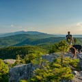 The granite ledges on Burnt Rock Mountain offer unencumbered views of the surrounding mountains and valleys.- Ultimate Leaf-Peeping Road Trip through New England