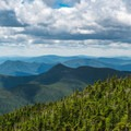 Surrounded by mountains in the Mount Carrigain fire tower.- 20 Must-Do Hikes in New Hampshire