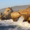 Waves rolling into Cape Kiwanda.- The People's Coast