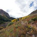 Climbing up through the canyon awash in fall color to Cathedral Lake.- Epic Fall Hikes Through the Rockies