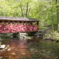 Discover a picturesque covered bridge tucked away in the woods at Chatfield State Park.- 15 Must-Visit New England State Parks