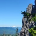 The dramatic cliffs near the top of Tidbits Mountain provide a photogenic backdrop for the mountains.- Exploring Oregon Watersheds: Adventure Brews