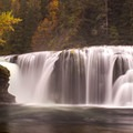 A spectacular wall of water at Lewis River Falls.- Best Hikes for Fall Colors in Washington