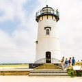 Visitors admiring Edgartown Harbor Lighthouse.- Guide to East Coast Lighthouses