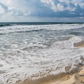 Waves rolling in at Cape Point Beach.- 7 Best Beaches of North Carolina's Outer Banks