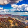 An autumn view from the Craggy Gardens Pinnacle on the Blue Ridge Parkway. - A Guide to Leaf-peeping Weekends in the Blue Ridge Mountains