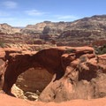 Cassidy Arch. Notice the hiker standing on top for scale.- Utah's Best Fall Adventures