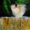 Boofing into a narrow double drop on Brokeback Gorge.- Whitewater Paddling The Northeast Classics