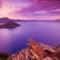 A vibrant sunset from Discovery Point in the summer months.- Winter Adventures in Crater Lake National Park