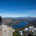 Donner Peak (8,020 ft) is perched over Donner Lake, I-80 to the left, the Union Pacific railroad route to the right, and the abandoned railroad tunnels straight down.- Destination Lake Tahoe: Where Incredible Backcountry Snow Adventures Await