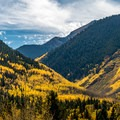 View up the Conundrum Valley from Castle Creek Road. There is a popular trailhead here.- 30 Spectacular Fall Adventures in Colorado