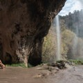 Behind the falls at Rifle Falls State Park.- Western State Parks That Will Blow Your Mind