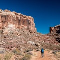 Hiking along the canyon floor at Horseshoe Canyon.- Utah's Best Fall Adventures