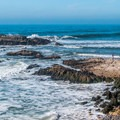 Walking out to one of the points at Pescadero State Beach.- California's Best Beaches