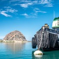 The venerable tugboat moored in the harbor of Morro Bay.- An Introduction to Stand-up Paddleboarding