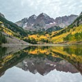 Maroon Bells, Colorado, at sunrise.- The Best Leaf-Peeping Adventures for Fall Foliage