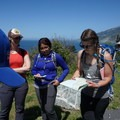 Trail Mavens guide showing the crew how to read a map. - 5 Tips for Dealing With Jealousy When You Have Anxiety + Depression
