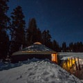 The Geyser Pass Yurt lit up by a full moon.- Unbeatable Winter Adventures in Utah