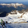 Mount Baker: Descending the Roman Wall: Colfax Peak is below, and Boston Basin is in the distance.- 35 Summit Views Worth Hiking For