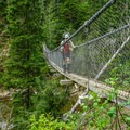 A high suspension bridge on the West Coast Trail.- Must-do Scenic Drives in the Pacific Northwest