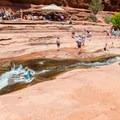 Natural waterslide at Slide Rock State Park.- Arizona Swimming Holes