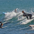 The waves can get crowded at times surfing at Pleasure Point.- Pleasure Point