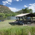 One of a few sites with a picnic shelter at Inlet Bay Campground, Horsetooth Reservoir County Park.- Horsetooth Reservoir County Park