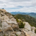 Hikers standing on Chocorua's summit.- Incredible Adventures in New Hampshire's White Mountain National Forest