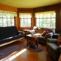 Living room with a fold-out futon sofa at the Hamma Hamma Guard Station.- 5 Great Winter Lodging Options on the Olympic Peninsula