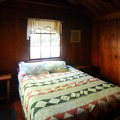 Bedroom with a queen bed in the Hamma Hamma Guard Station.- 5 Great Winter Lodging Options on the Olympic Peninsula