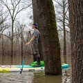Maneuvering through a flooded forest in Louisiana.- Gear Review: Bote HD Aero Stand-up Paddleboard