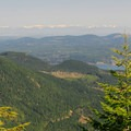 View from Jefferson Ridge east to Green and Gold Mountain and the Cascade Range beyond.- Dramatic Fjord Formations