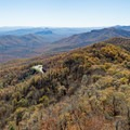 Southward view of the Blue Ridge Parkway and Looking Glass Rock from the Frying Pan Lookout Tower. - A Guide to Leaf-peeping Weekends in the Blue Ridge Mountains
