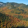 Looking up at Gothics from Indian Head.- 15 Must-see Fall Foliage Adirondack Adventures