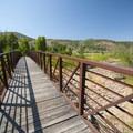 Pedestrian bridge over Provo River at Rock Cliff Campground.- Jordanelle State Park