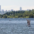 Stand-up paddleboards and the Seattle skyline from Juanita Beach Park.- Beat the Heat: Seattle Summer Escapes