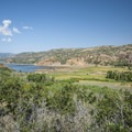 View of Jordanelle State Park's Rock Cliff Campground and Provo River wetlands from UT-32.- Jordanelle State Park