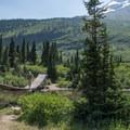 A tricky swinging bridge across the creek below Gunsight Lake.- Glacier National Park
