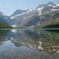 Gunsight Lake with Gunsight Pass behind.- 6 Epic Hikes in Glacier National Park