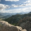 View south to Estes Park and Rocky Mountain National Park including Longs Peak (14,259 ft) from Lumpy Ridge.- National Park System