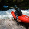 Sliding in from the portage around Gorilla at the Green River Narrows.- 10 Summer Escapes to Cool Off in North Carolina