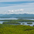 Catch amazing views of fall foliage surrounding Lake Winnipesaukee from the summit of Mount Major.- 15 Best Hikes for New Hampshire Fall Foliage