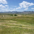 View west to the Front Range from Bear Creek Lake Regional Park.- Denver's Best Parks