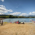 Swimming area at Kulshan Campground with views of Mount Baker (10,771 ft) and Mount Shuksan (9,131 ft).- Complete Guide to Baker Lake