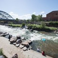 Floaters making their way down the South Platte River at Confluence Park.- Denver's Best Parks